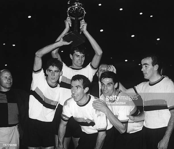 Armando Picchi captain of the Internazionale or Inter football team celebrates his team's win in the World Club Championship at the Santiago Bernabeu...