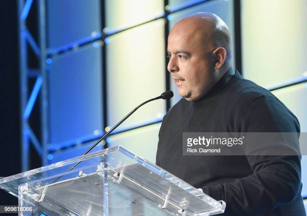 Armando Rodriguez Senior VP of Universal Music Latin Entertainment accepts an award onstage during the Music Biz 2018 Awards Luncheon for the Music...