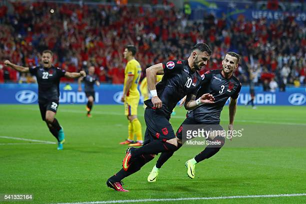 Armando Sadiku of Albania celebrates scoring his team's first goal with his team mate Ermir Lenjani during the UEFA EURO 2016 Group A match between...