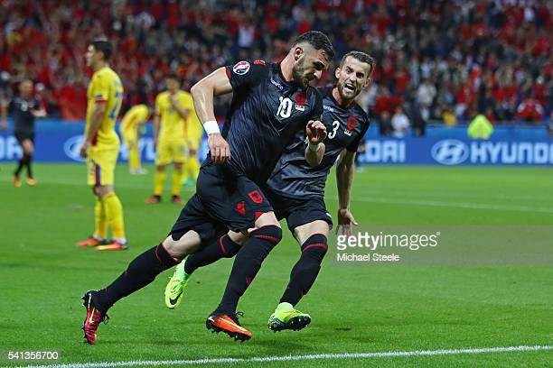 Armando Sadiku of Albania celebrates scoring his team's first goal with his team mate Ermir Lenjani during the UEFA EURO 2016 Group A match between...