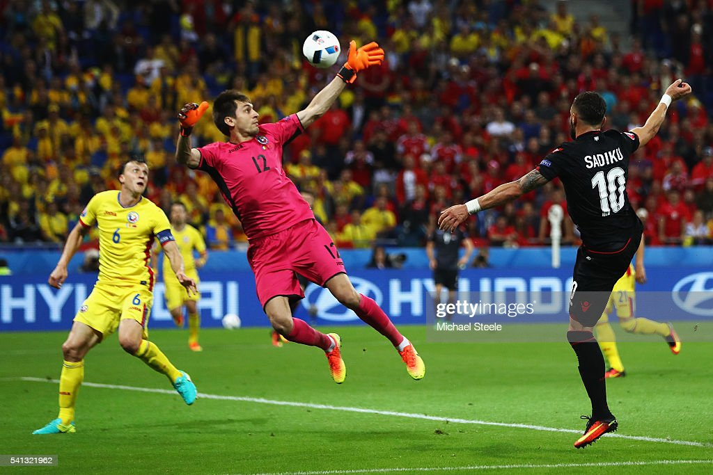 Armando Sadiku (R) of Albania heads the ball to score the opening goal past Ciprian Tatarusanu (C) of Romania during the UEFA EURO 2016 Group A match between Romania and Albania at Stade des Lumieres on June 19, 2016 in Lyon, France.