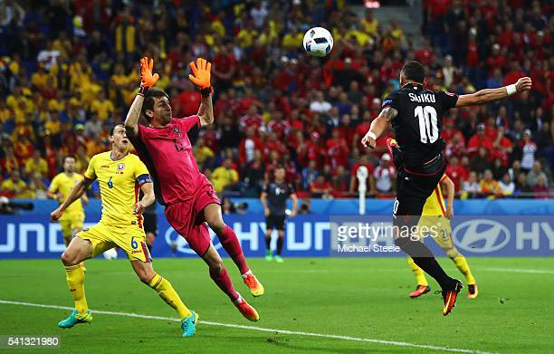 Armando Sadiku of Albania heads the ball to score the opening goal past Ciprian Tatarusanu of Romania during the UEFA EURO 2016 Group A match between...