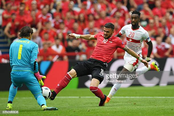 Armando Sadiku of Albania stretches for the ball during the UEFA EURO 2016 Group A match between Albania and Switzerland at Stade BollaertDelelis on...