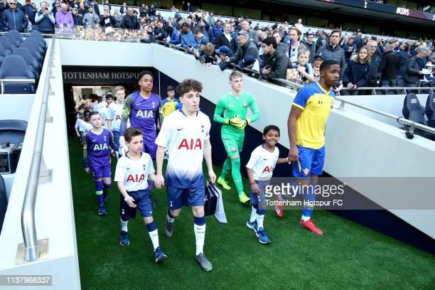 Armando Shashoua of Tottenham and Kayne Ramsay of Southampton lead their team's onto the pitch prior to the U18 Premier League between Tottenham...