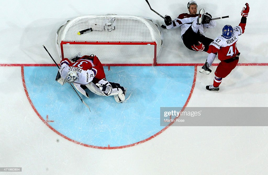 Armands Berzins (R) of Latvia is checked by Petr Koukal (L) of Czech Republic during the IIHF World Championship group A match between Latvia and Czech Republic at o2 Arenaon May 2, 2015 in Prague, Czech Republic.
