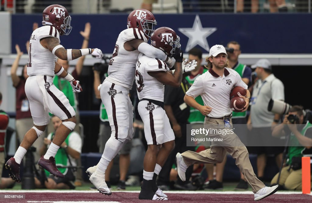 Armani Watts #23 of the Texas A&M Aggies celebrates a pass interception against the Arkansas Razorbacks in overtime at AT&T Stadium on September 23, 2017 in Arlington, Texas.