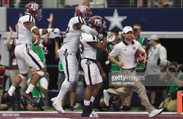Armani Watts of the Texas A&M Aggies celebrates a pass interception against the Arkansas Razorbacks in overtime at AT&T Stadium on September 23, 2017...