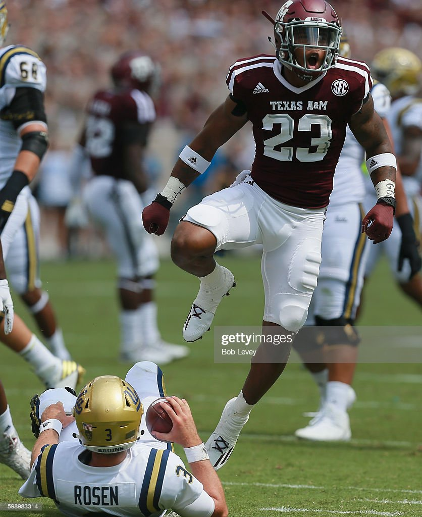 Armani Watts #23 of the Texas A&M Aggies celebrates his sack of Josh Rosen #3 of the UCLA Bruins at Kyle Field on September 3, 2016 in College Station, Texas.