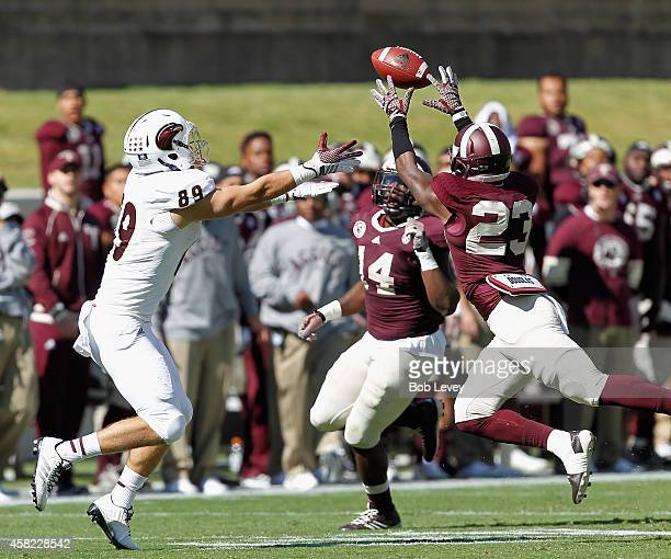 Armani Watts of the Texas AM Aggies intercepts a pass intended for Alec Osborne of the Louisiana Monroe Warhawks at Kyle Field on November 1 2014 in...