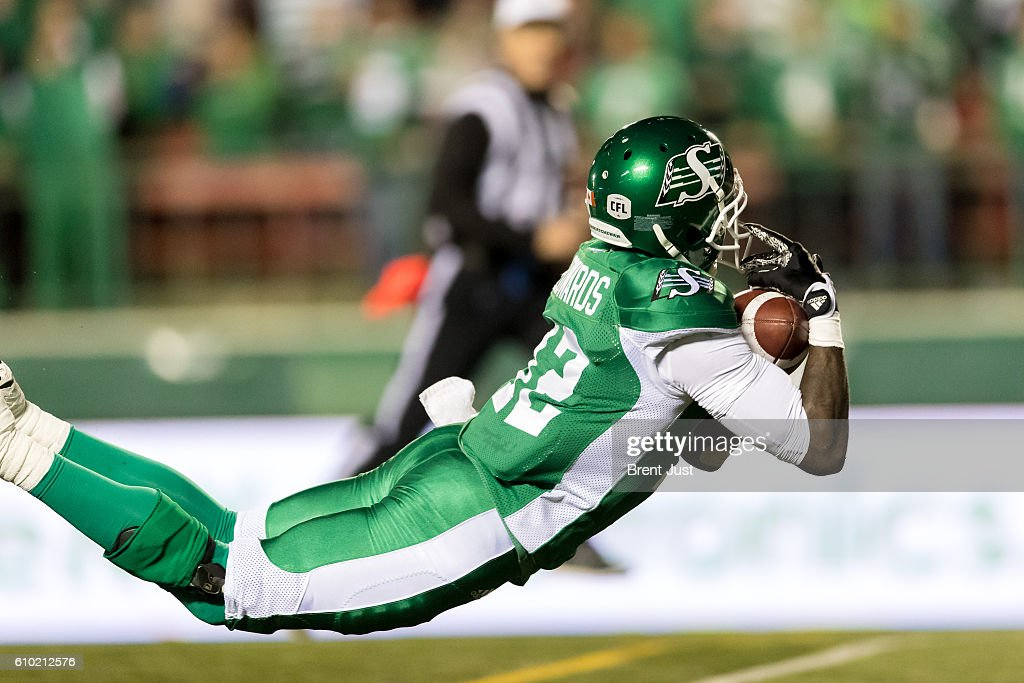 Armanti Edwards #12 of the Saskatchewan Roughriders makes a diving catch for a touchdown in the first half of the game between the Hamilton Tiger-Cats and Saskatchewan Roughriders at Mosaic Stadium on September 24, 2016 in Regina, Canada.