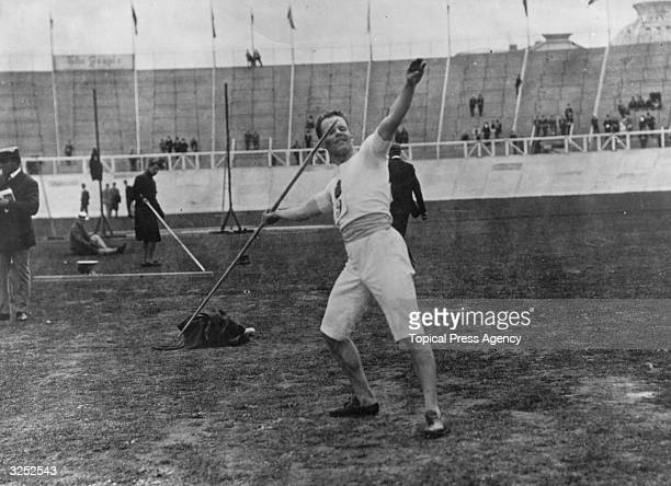 Armas Pesonen of Finland throws the javelin during preliminaries in the 1908 Olympic Games held in London he placed 5th in the final