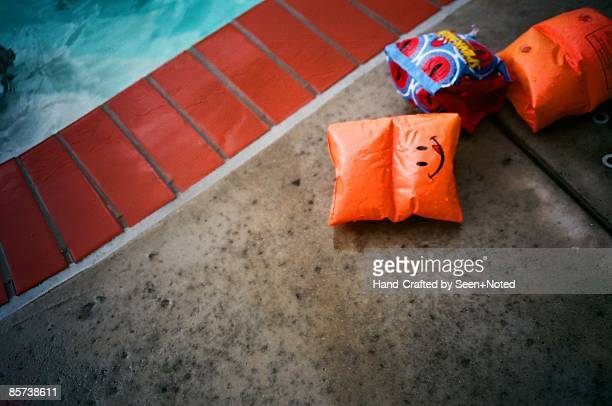 armband on poolside - armband stock pictures, royalty-free photos & images