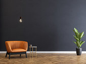 Armchair and coffee table with black wall