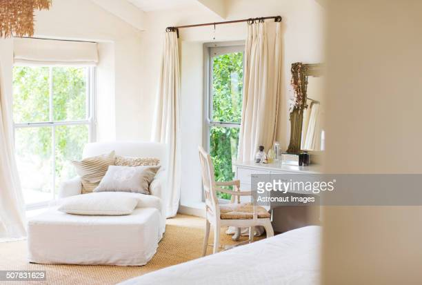 Armchair and vanity in rustic bedroom