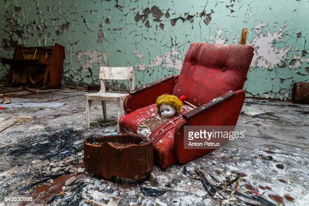 armchair in a kindergarten in the chernobyl zone. prypiat, ukraine - chernobyl stockfoto's en -beelden