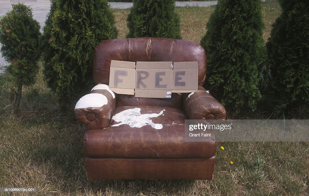 Armchair on grass with free'' sign : Stockfoto
