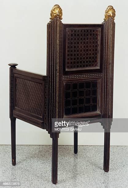 Armchair retro by Ettore Zaccari walnut with gilding Italy 20th century