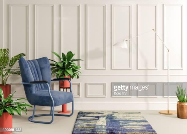 armchair with velvet navy blue - teppich stock-fotos und bilder