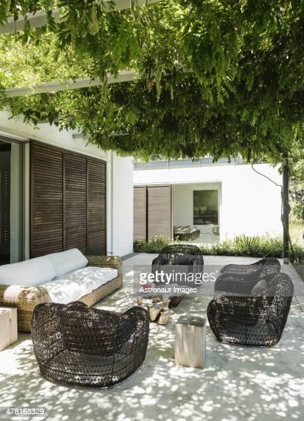 Armchairs and sofa on luxury patio