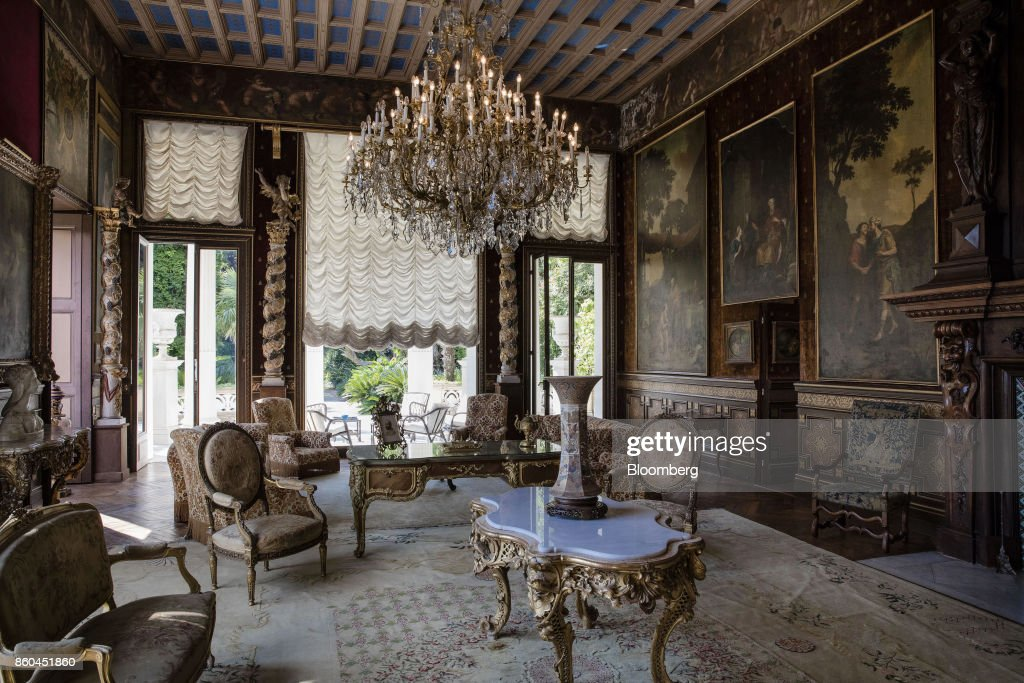 Armchairs and tables stand beneath chandeliers as 19th century portraits adorn the walls of a sitting room inside the Villa Les Cedres, a 187-year-old, 18,000-square-foot, 14-bedroom mansion set on 35 acres, in Saint-Jean-Cap-Ferrat, France, on Tuesday, Sept. 26, 2017. With a list price of 350 million ($410 million), the owner, the Italian distiller Davide Campari-Milano SpA, is betting that the houses combination of history, luxury, and a prime location along the coast of Saint-Jean-Cap-Ferrat will be enough to make it the most expensive residential sale in history. Photographer: Marlene Awaad/Bloomberg via Getty Images