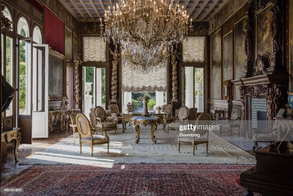 Armchairs and tables stand beneath chandeliers as 19th century portraits in ornate frames adorn the walls of a sitting room inside the Villa Les Cedres, a 187-year-old, 18,000-square-foot, 14-bedroom mansion set on 35 acres, in Saint-Jean-Cap-Ferrat, France, on Tuesday, Sept. 26, 2017. With a list price of 350 million ($410 million), the owner, the Italian distiller Davide Campari-Milano SpA, is betting that the houses combination of history, luxury, and a prime location along the coast of Saint-Jean-Cap-Ferrat will be enough to make it the most expensive residential sale in history. Photographer: Marlene Awaad/Bloomberg via Getty Images