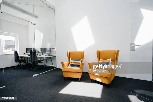 Armchairs in empty modern office