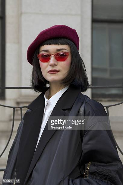 Arme Lola seen at The Arc Skylight at Moynihan Station outside the Tadashi Shoji show wearing maroon beret pink Dior sunglasses vintage jacket and...