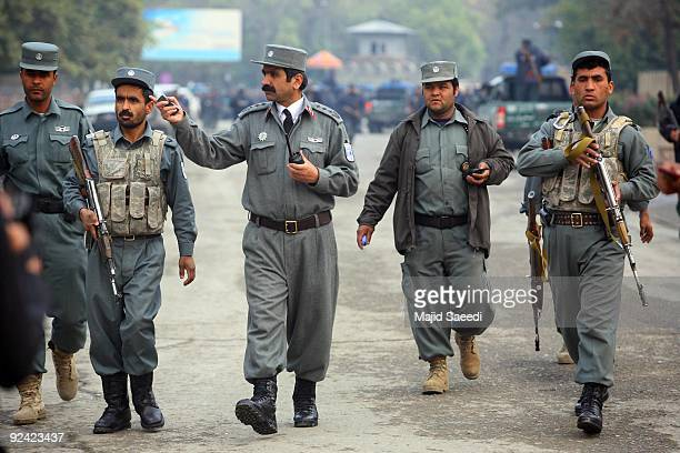 Armed Afghan police arrive at the five star Serena Hotel following a rocket attack on Octber 28 2009 in Kabul Afghanistan A senior Afghan police...