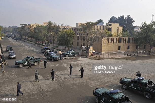 Armed Afghan police surrround the five star Serena hotel in central Kabul on October 28 following a rocket attack after Bekhtar guesthouse was...