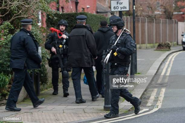 Armed and specialist Police officers head into the cordon after a man was shot and killed by armed police on February 2 2020 in London England The...