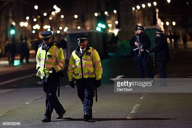Armed and unarmed police officers patrol ahead of the fireworks on December 31 2015 in London England Thousands of people have bought tickets to...