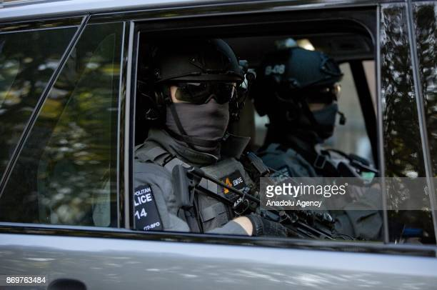 SFO armed antiterrorism police watch over demonstrators as Israeli Prime Minister Benjamin Netanyahu arrives to Chatham House in London England where...