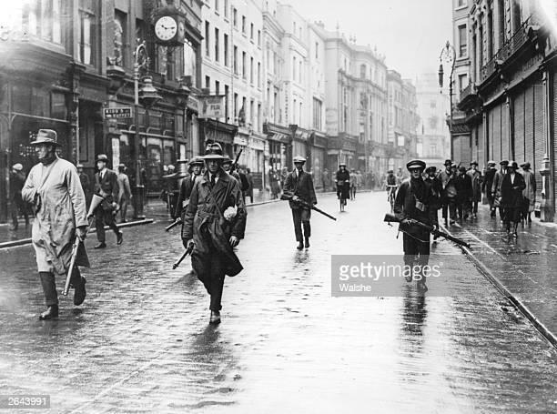 Armed anti-Treaty members of the Irish Republican Army in Grafton Street, Dublin during the Irish Civil War.