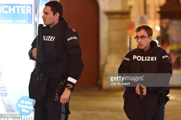 Armed Austrian policemen stop traffic from a pedestrian and shopping area in Vienna on November 2 after a shooting in the city centre. - Multiple...