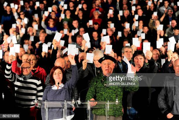 Armed Basque separatist group ETA exprisoners Begona Uzkudun and Angel Alcalde hold ballots as they take part in a press conference acting on behalf...