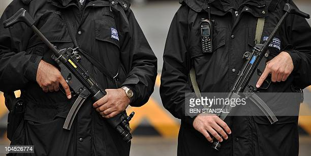 Armed British police officers pose for a photograph in central London on September 29 2010 Washington's top intelligence official on Wednesday...