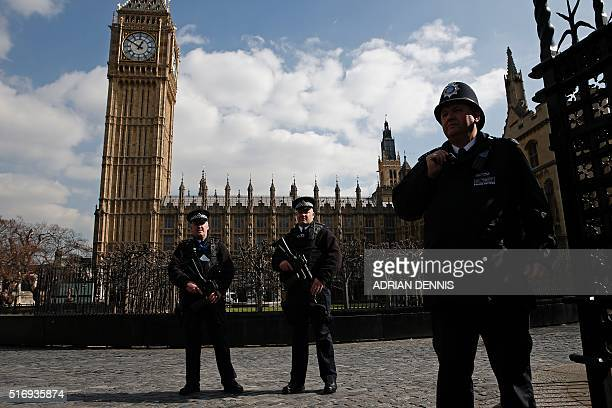 Armed British police officers stand on duty in front of the Elzabeth Tower better known as 'Big Ben' outside the vehicle entrance to the Houses of...