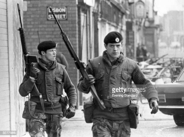 Armed British soldiers on patrol in Lisbon Street Belfast during the Official IRA's unconditional ceasefire