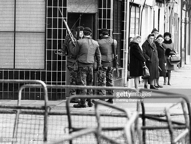 Armed British soldiers patrolling the streets of Belfast during the Official IRA's unconditional ceasefire