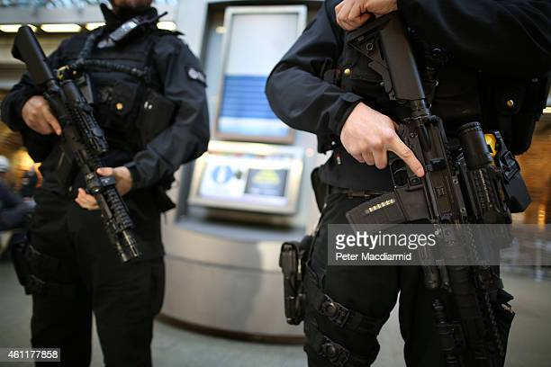 Armed British Transport Police officers patrol the Eurostar platforms at St Pancras railway station on January 8 2015 in London United Kingdom France...