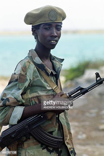 Armed child soldier carrying his AK47 during Somalia's ongoing civil war