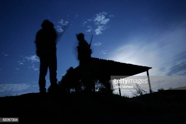 Armed citizen volunteers carry out nightly patrols in search of illegal border crossers from Mexico on July 20, 2005 near Campo, California in...