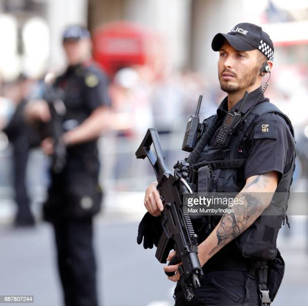 Armed City of London Police Officers on duty outside St Paul's Cathedral during a service to mark the one hundredth anniversary of The Order of The...