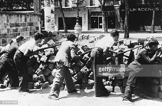 Armed civilians guard a barricade during the Spanish Civil War | Location Barcelona Spain