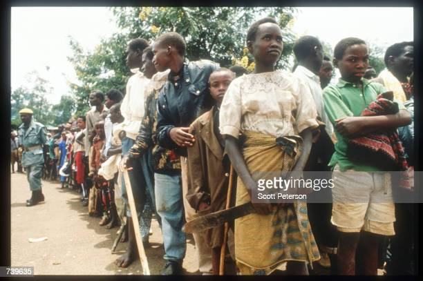 Armed civilians wait for Red Crossdelivered food April 13 1994 in Kigali Rwanda Following the apparent assassination of Rwandan President Juvenal...