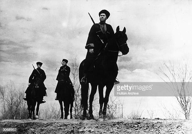 Armed Cossacks on their ponies during WW II