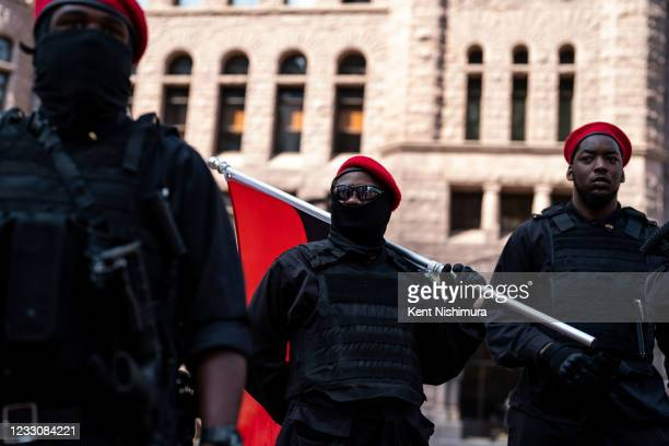 Armed demonstrators before the start of the inaugural remembrance rally and march hosted by the George Floyd Global Memorial, commemorating the first...