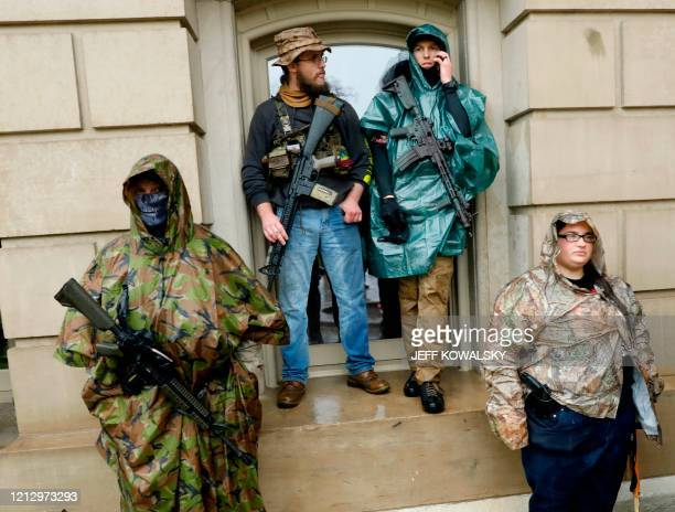 TOPSHOT Armed demonstrators protest in Lansing Michigan during a rally organized by Michigan United for Liberty on May 14 to protest the coronavirus...
