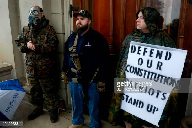 Armed demonstrators protest in Lansing Michigan during a rally organized by Michigan United for Liberty on May 14 to protest the coronavirus pandemic...