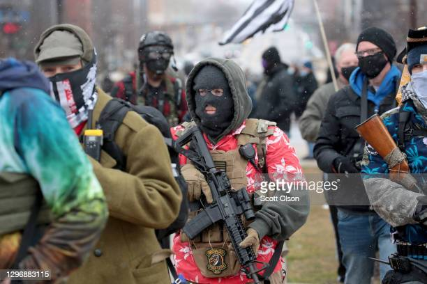 Armed demonstrators protest outside of the Michigan state capital building on January 17, 2021 in Lansing, Michigan. Supporters of President Trump...